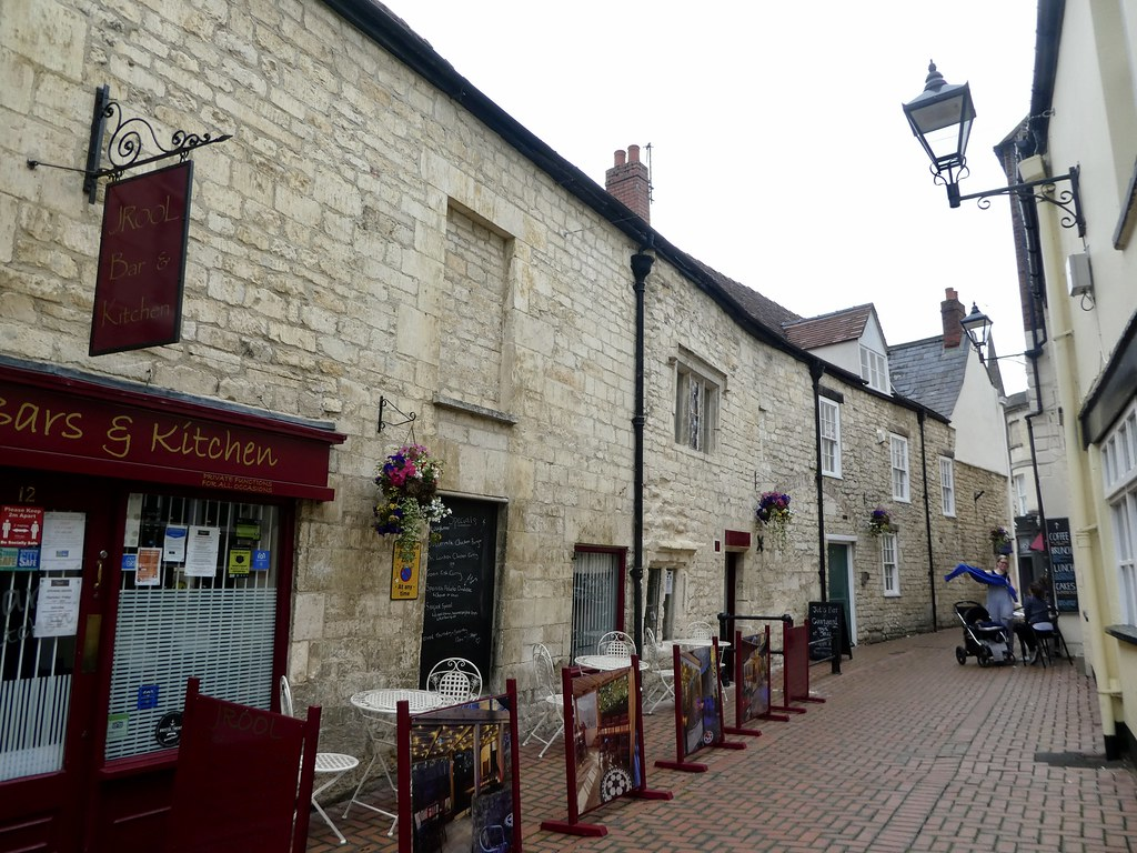 Pavement cafes along narrow alleyways in Stroud