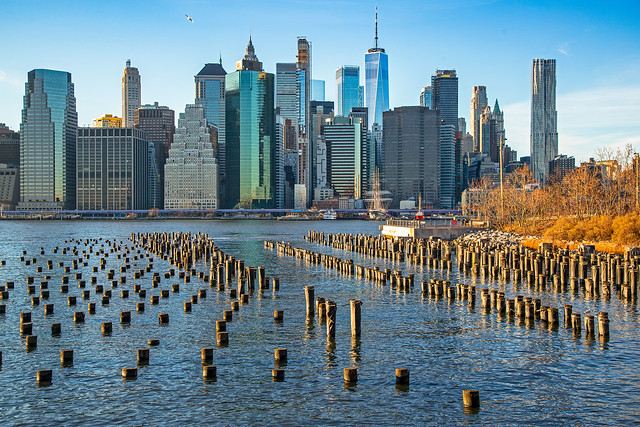 Old piers, East River, and Manhattan