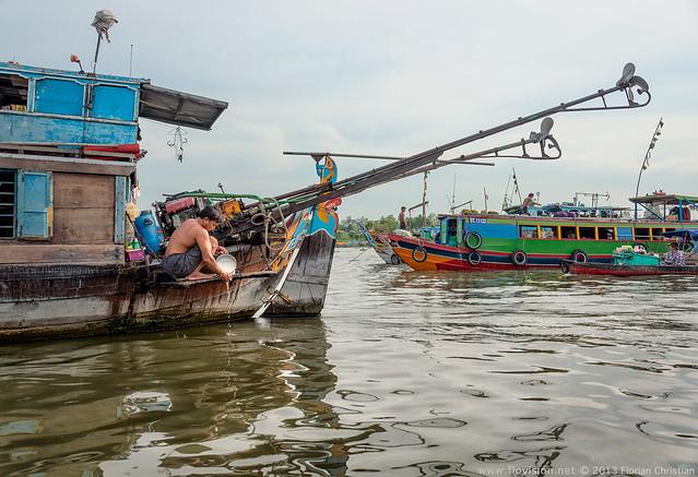 Rinsing rice, along the Mekong, Vietnam
