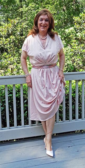 Redhead in sedate pink dress