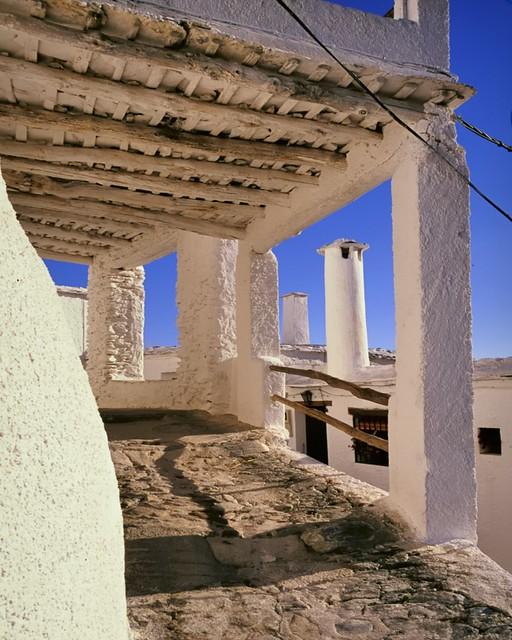 Hillside house balcony and chimney pots, Lanjarón, Alpujarra, Andalusia, Spain.