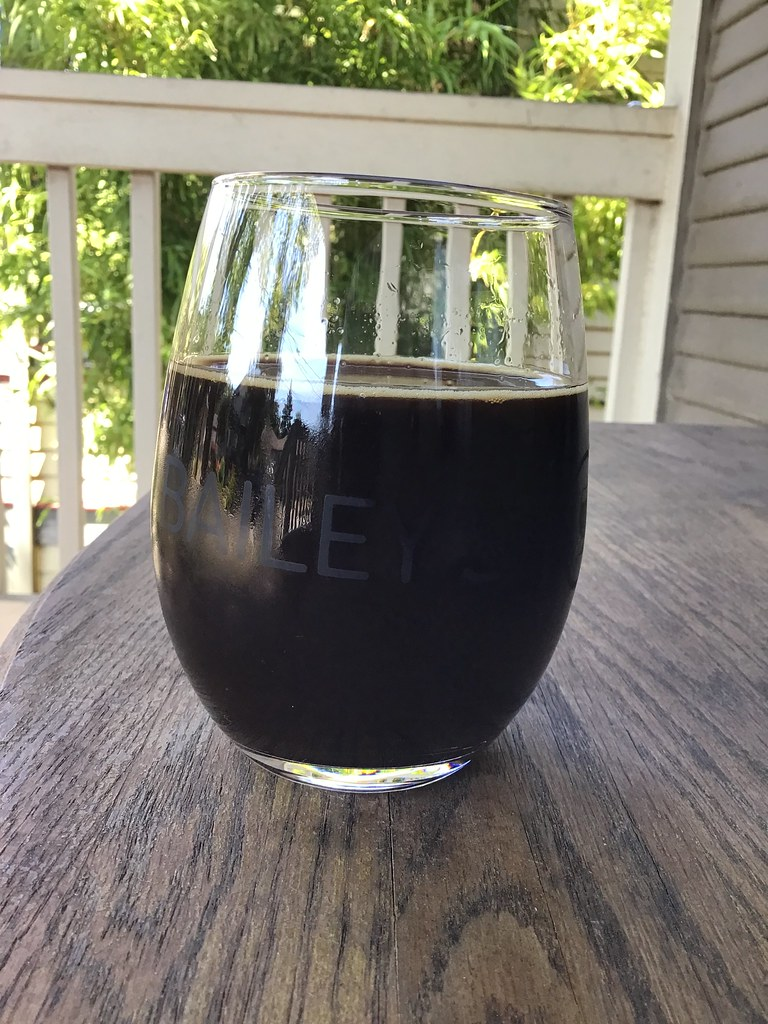 Abominable & Skygazer collaboration: Dreamatorium stout in glass on table outside