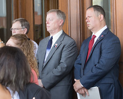 State Reps. Mike France and Craig Fishbein listen during a press conference calling for a special legislative session to deal with the growing issue of juvenile crime and car theft.
