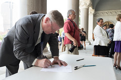 State Rep. Mike France signs a petition calling for a special legislative session to tackle the growing issue of juvenile crime and car theft.