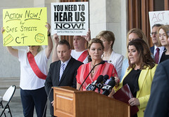 State Rep. Nicole Klarides-Ditria and her colleagues listen to New Britain Mayor Erin Stewart during a press conference calling for a special legislative session to deal with the growing issue of juvenile crime and car theft.