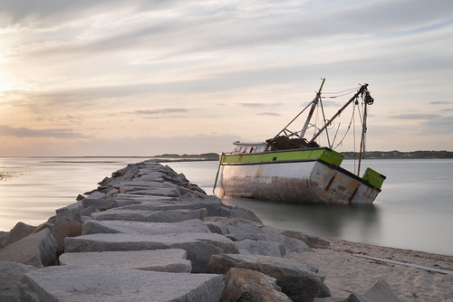 abandoned america american unitedstates usa ship shipwreck boat shipwrecked myyot provincetown ptown jetty ocean water waterscape sand beach sunset glow golden sky clouds longexposure sea massachusetts newengland cape capecod exterior yellow pink blue white reflection lost lostplace forgotten frozenintime antique vintage perspective old classic history time memories decay derelict details urbex urbanexploration exploration explore explorer wreck wreckage