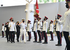Adm. Samuel Paparo reviews an honor guard at the Singapore Ministry of Defence, July 8. (Singapore MINDEF courtesy photo)
