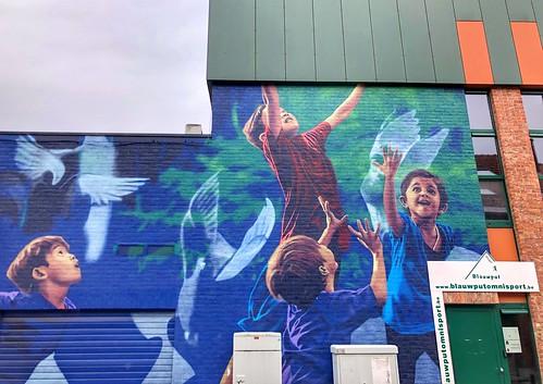 "mural ""No Destinies Ordained"" by artist Nean"