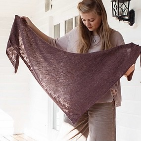 Irish Sea by Susanna Winter is a super-wearable triangle shawl with beautiful drape knit in The Fibre Co Meadow. Show in Ladyslipper.