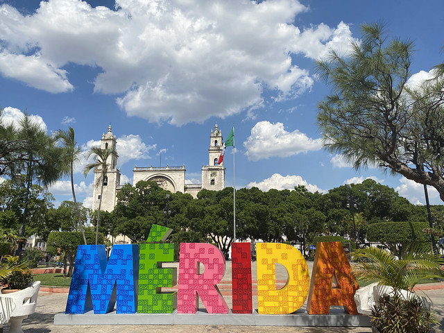 church and sky and Merida sign