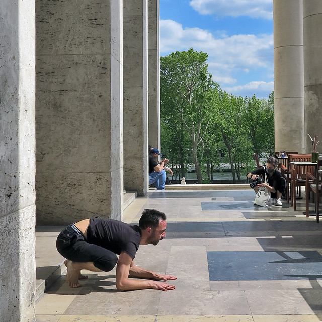 Photographing a gymnastics exhibition among the columns of the Museum of Modern Art