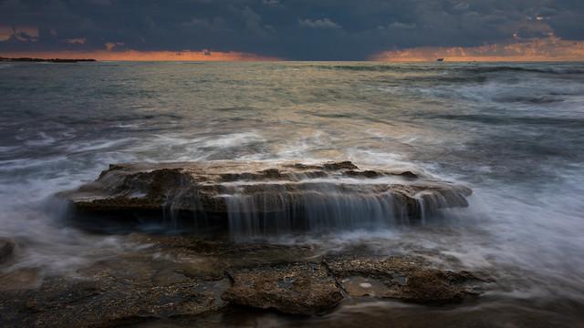 Rocky beach sunset