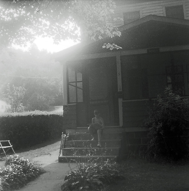 A friend of mine reads the evening edition of the New Haven Register while his mom cooks dinner. If this was a color photo it would be bathed in a gorgeous golden glow of the setting summer sun behind the trees in the background. Milford CT. July 1973