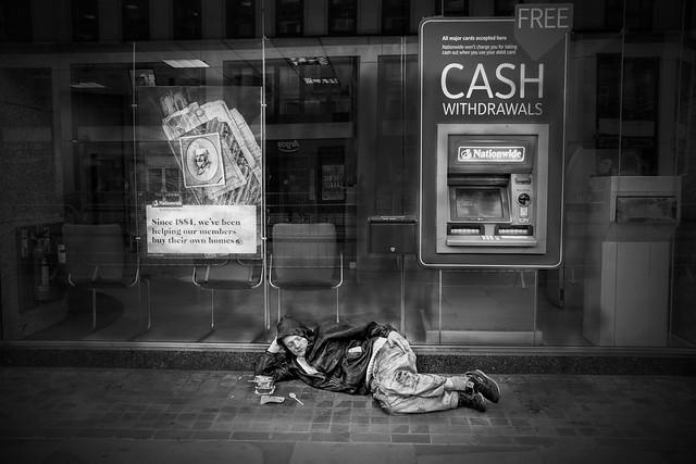 Ironic. Housing crisis. Homeless man on the Strand, London