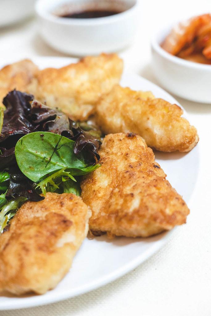 Saengseon jeon served with sangchu geotjeori.
