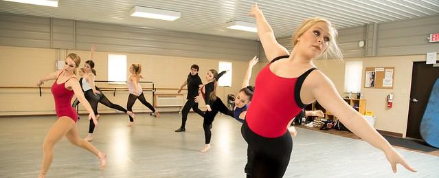 Dancers practice in dance studio