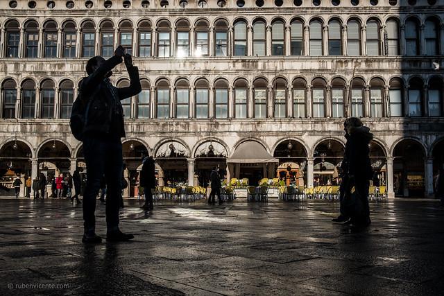 Man taking a photo at Piazza San Marco
