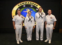 U.S. Pacific Fleet Shore Sailor of the Year Navy Counselor 1st Class Brittany F. Flowers and Sea Sailor of the Year Intelligence Specialist 1st Class Michael W. Bukowski pose for a photograph with Adm. Samuel Paparo, commander of Pacific Fleet, and Pacific Fleet Master Chief Master Chief James R. Tocorzic. (U.S. Navy/MC1 Robert Zahn)