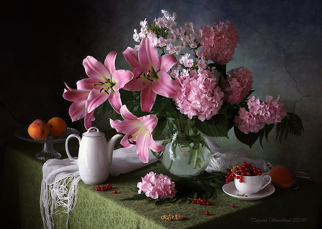 With a bouquet of lilies and fruits