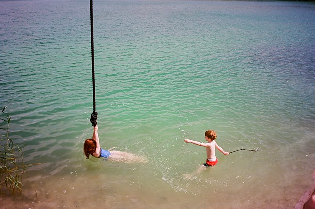swinging in the blue water