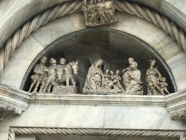 Como Cathedral :Facade- Lunette of the left portal - Adoration of the Shepherds - Sculpthres of the Rodari .