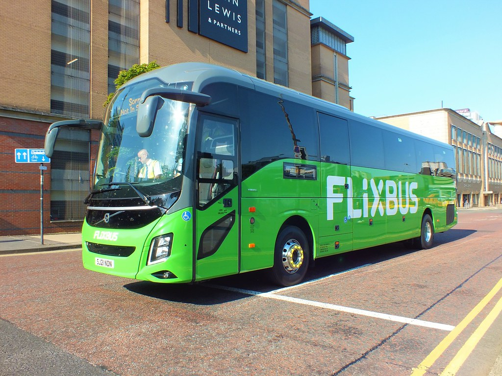 SJ21NDN McGills Flixbus Volvo 9700 leaves Buchanan Street bus station after dropping off the remaining passengers after its journey from London