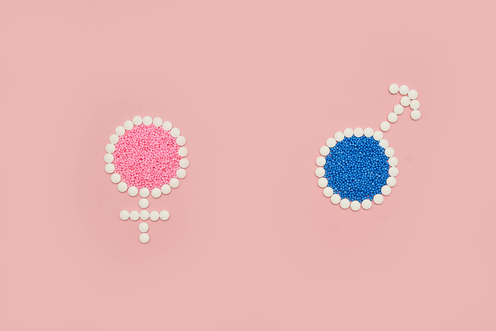 Male and female signs made of medical pills
