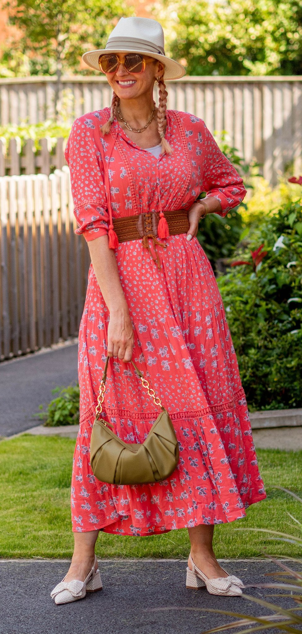 Catherine Summers AKA Not Dressed As Lamb wearing boho coral maxi summer dress, slingback bow-front mules, brown plaited belt, cream Panama hat and pink and orange 1970s-style oversized sunglasses