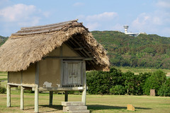 Yayoi trading house with Ikikoku Museum in the background