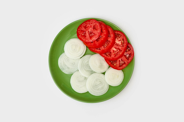 A bowl of sliced tomatoes and onions