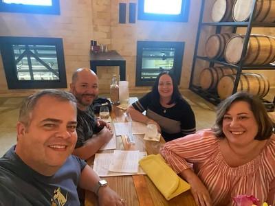 Gulf Coast Distillers Enjoying Drinks and Company