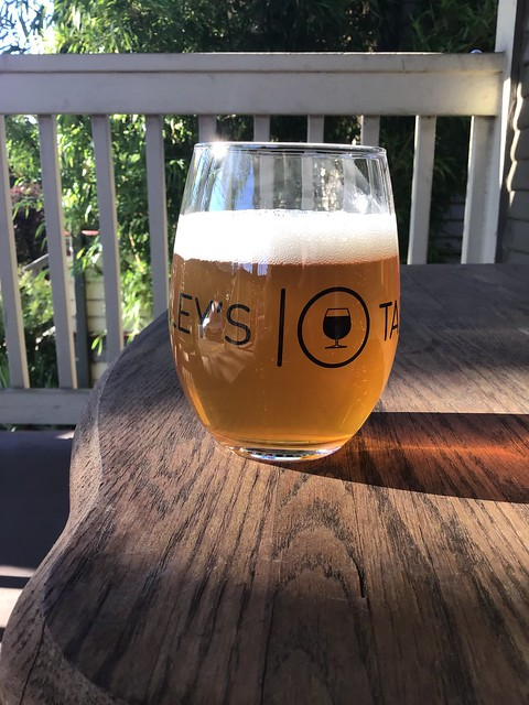 Super Chief IPA by Brothers Cascadia Brewing, in glass on table outside