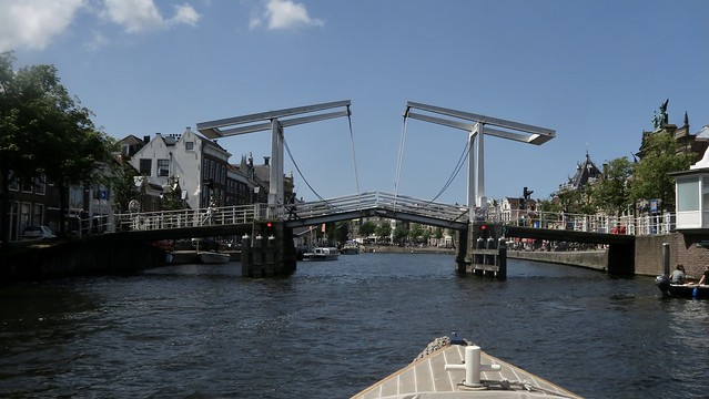 Sailing through the city of Haarlem, Netherlands, on the river Spaarne.