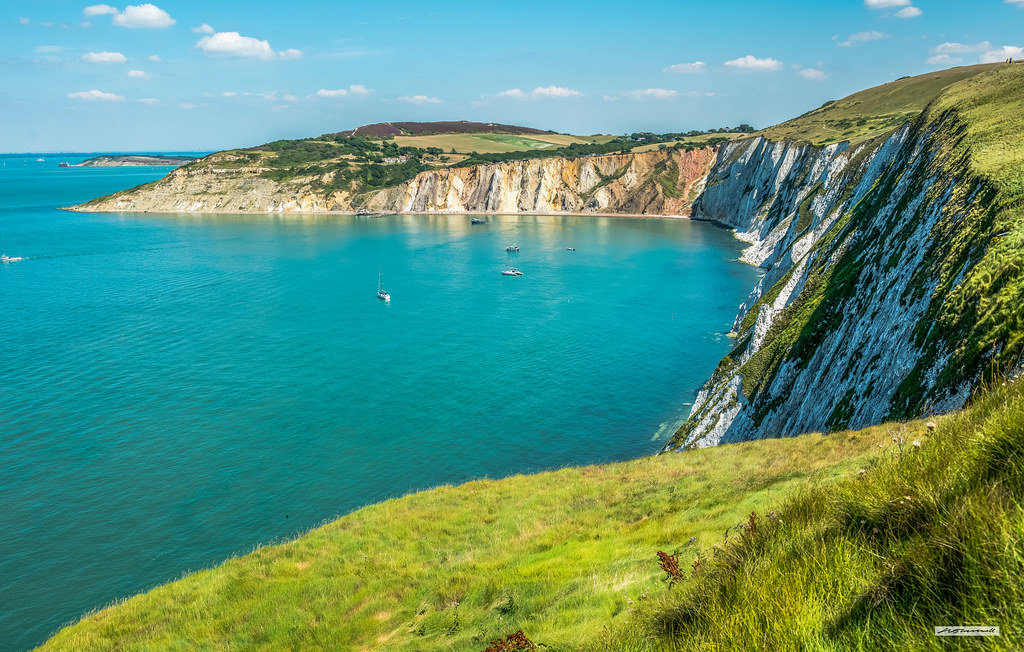 The colourful sands of Alum Bay viewed from near to the Needles Coastguard Station, Isle of Wight, England.