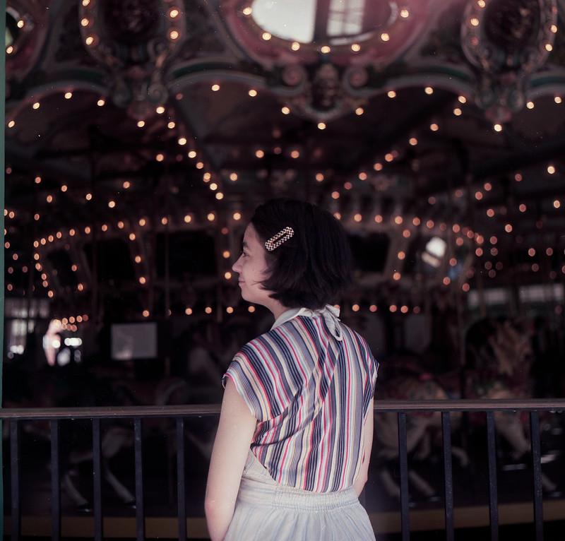 Zofie on the Carousel [Kiev 60 / Kodak Portra 160]