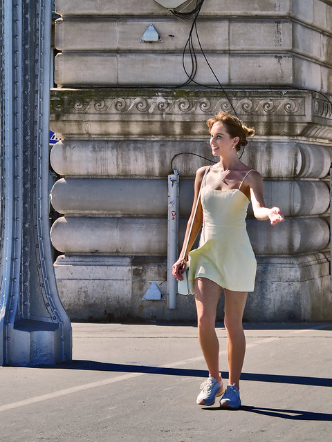 Nice girl photographed walking on the Bir Hakeim bridge
