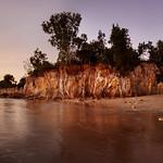 Golden light at Fannie Bay cliffs (pano)