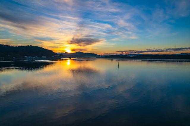 High cloud sunrise winter waterscape