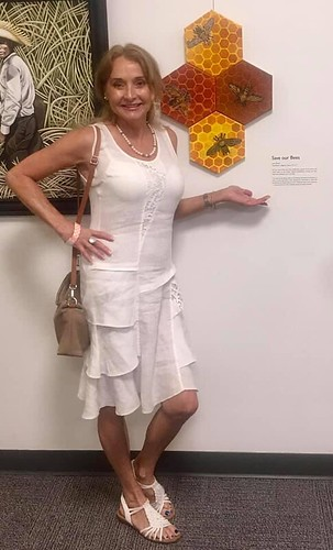 """Artist Lisa Simon with her work """"Save Our Bees"""". Used with permission."""