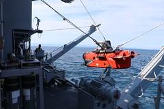Sailors aboard the mine countermeasures ship USS Warrior (MCM 10) deploy a mine neutralization vehicle during MIWEX 2JA, July 19. (U.S. Navy)