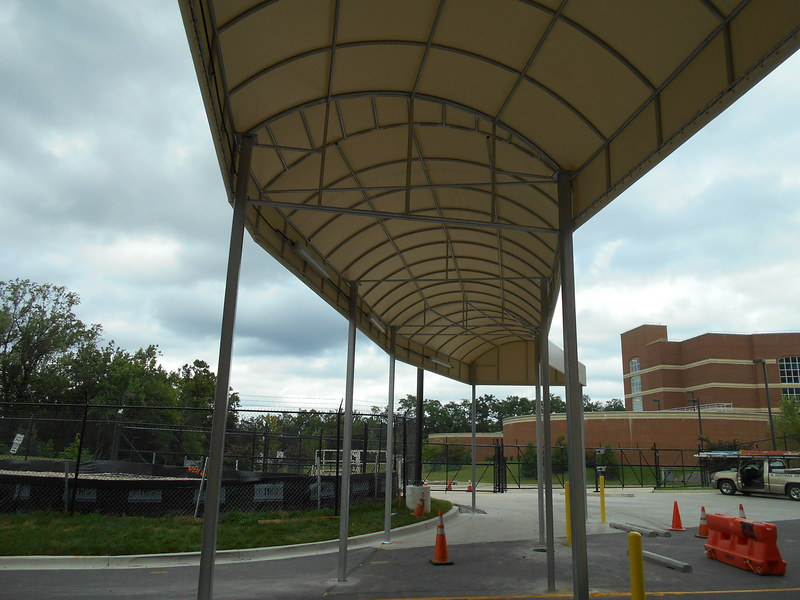 lift-capabilities-constructing-long-contoured-entrance-canopyby-a-hoffman-awning