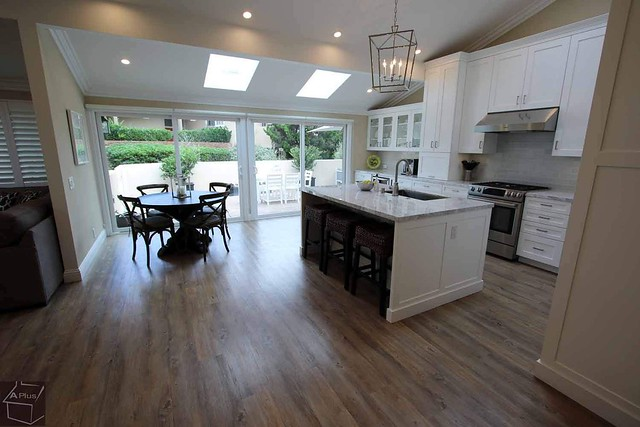 Kitchen Remodel with custom white Aplus cabinets in the city of Newport Beach Orange County https://www.aplushomeimprovements.com/portfolio_page/129-newport-beach-transitional-design-build-home-kitchen-remodel/