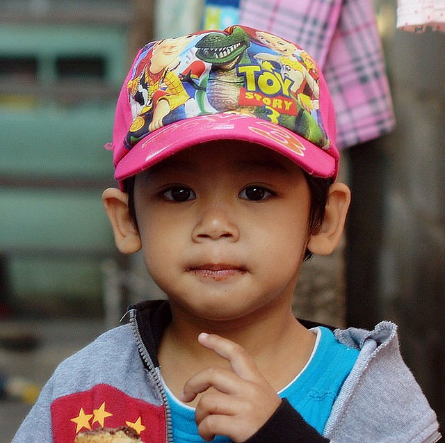 handsome boy with colorful cap