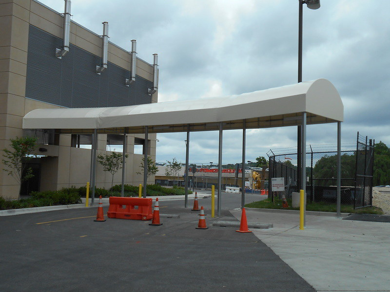 lift-capabilities-constructing-long-contoured-entrance-canopy-hoffman-awning
