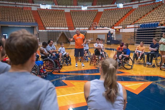 Auburn Men's Basketball Coach Bruce Pearl talks to Auburn Wheelchair Basketball Summer Camp participants.