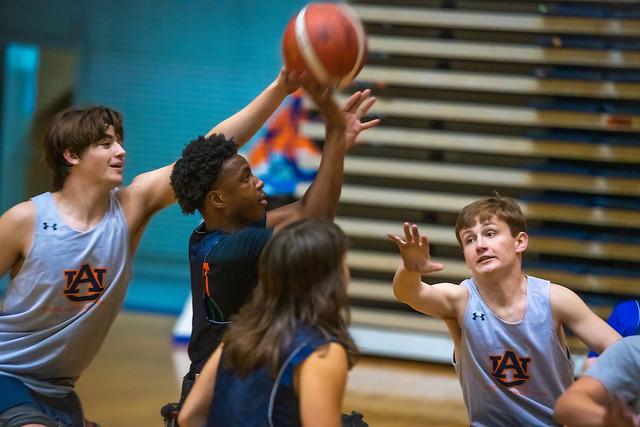Auburn Wheelchair Basketball Summer Camp participants compete in a game.