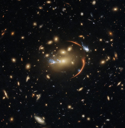 Hubble Views a Faraway Galaxy Through a Cosmic Lens