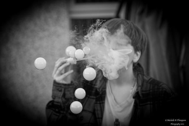 Blowing vape filled bubbles