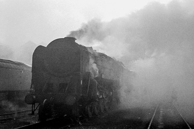 On the cold, foggy morning of 3rd December 1967 a BR 9F 2-10-0 heavy goods engine awaits its next turn of duty in the shed yard at Carlisle Kingmoor MPD. Four weeks later steam traction over Shap ceased and the steam shed at Kingmoor closed. (EXPLORED)