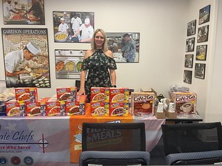 Erin Lee, Heater Meals Sales Manger ready and excited to share her product with Fort Bragg Food Service Team